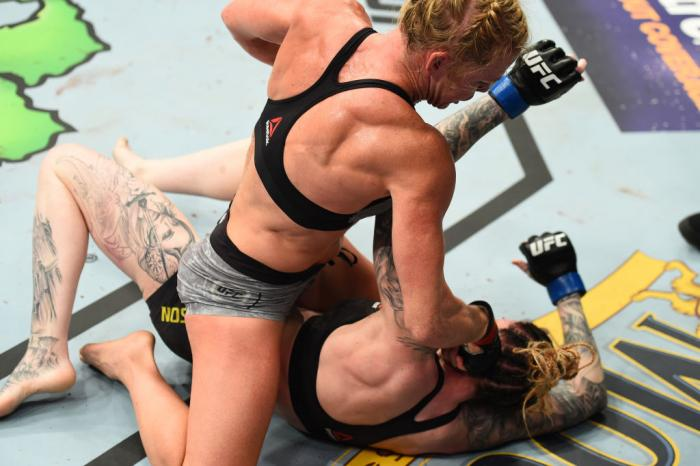 CHICAGO, ILLINOIS - JUNE 09:  (R-L) Holly Holm punches Megan Anderson of Australia in their women's featherweight fight during the UFC 225 event at the United Center on June 9, 2018 in Chicago, Illinois. (Photo by Josh Hedges/Zuffa LLC/Zuffa LLC via Getty