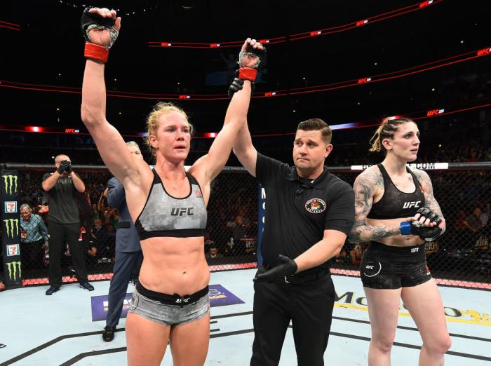 CHICAGO, ILLINOIS - JUNE 09:  (L-R) Holly Holm celebrates after defeating Megan Anderson of Australia in their women's featherweight fight during the UFC 225 event at the United Center on June 9, 2018 in Chicago, Illinois. (Photo by Josh Hedges/Zuffa LLC/