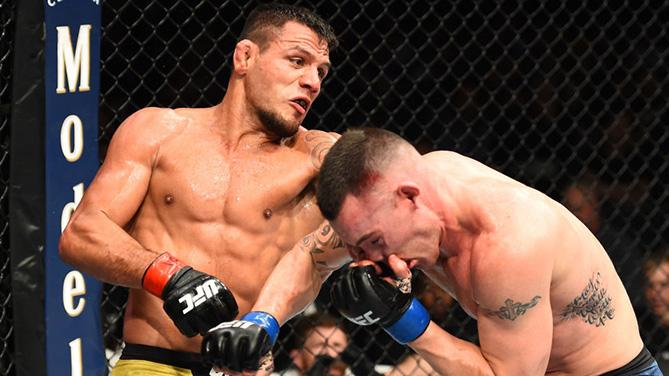 CHICAGO, ILLINOIS - JUNE 09:  (L-R) Rafael Dos Anjos of Brazil punches Colby Covington in their interim welterweight title fight during the UFC 225 event at the United Center on June 9, 2018 in Chicago, Illinois. (Photo by Josh Hedges/Zuffa LLC/Zuffa LLC