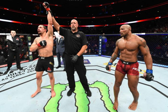 CHICAGO, ILLINOIS - JUNE 09:  (L-R) Robert Whittaker of New Zealand reacts after defeating Yoel Romero of Cuba in their middleweight fight during the UFC 225 event at the United Center on June 9, 2018 in Chicago, Illinois. Whittaker won by split decision.