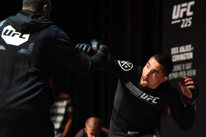 CHICAGO, ILLINOIS - JUNE 06:   Robert Whittaker of New Zealand works out for fans and media during the UFC 225 Open Workouts at the Chicago Theatre on June 6, 2018 in Chicago, Illinois. (Photo by Josh Hedges/Zuffa LLC/Zuffa LLC via Getty Images)