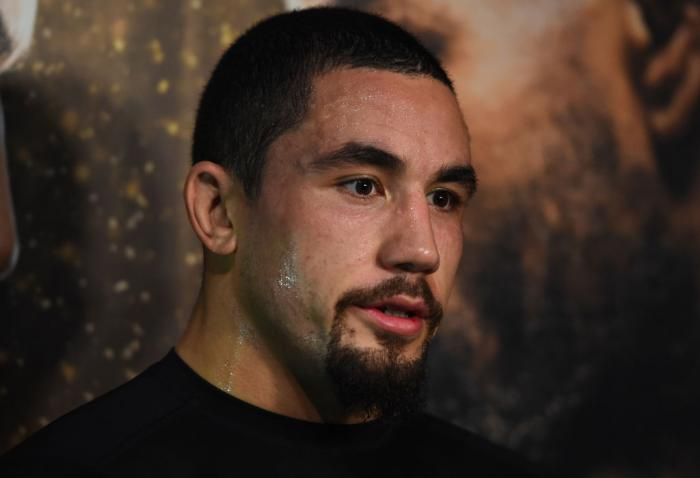 CHICAGO, ILLINOIS - JUNE 06:   Robert Whittaker of New Zealand interacts with media during the UFC 225 Open Workouts at the Chicago Theatre on June 6, 2018 in Chicago, Illinois. (Photo by Josh Hedges/Zuffa LLC/Zuffa LLC via Getty Images)