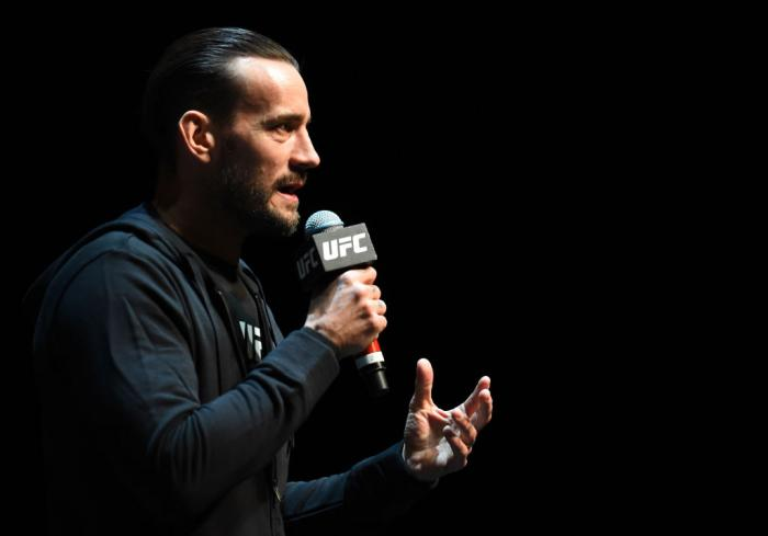 CHICAGO, ILLINOIS - JUNE 06:   CM Punk interacts with fans during the UFC 225 Open Workouts at the Chicago Theatre on June 6, 2018 in Chicago, Illinois. (Photo by Josh Hedges/Zuffa LLC/Zuffa LLC via Getty Images)