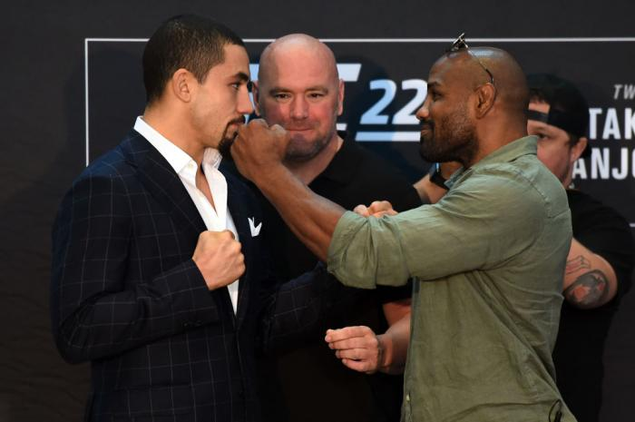 CHICAGO, ILLINOIS - JUNE 07:   (L-R) Opponents Robert Whittaker of New Zealand and Yoel Romero of Cuba face off during the UFC 225 Ultimate Media Day at the United Center on June 7, 2018 in Chicago, Illinois. (Photo by Josh Hedges/Zuffa LLC/Zuffa LLC via