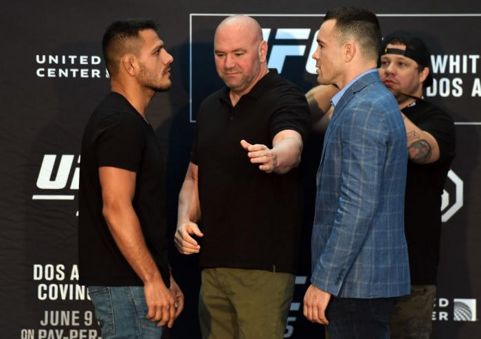CHICAGO, ILLINOIS - JUNE 07:   (L-R) Opponents Rafael Dos Anjos of Brazil and Colby Covington face off during the UFC 225 Ultimate Media Day at the United Center on June 7, 2018 in Chicago, Illinois. (Photo by Josh Hedges/Zuffa LLC/Zuffa LLC via Getty Ima