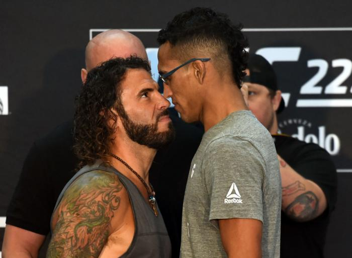 CHICAGO, ILLINOIS - JUNE 07:   (L-R) Opponents Clay Guida and Charles Oliveira of Brazil face off during the UFC 225 Ultimate Media Day at the United Center on June 7, 2018 in Chicago, Illinois. (Photo by Josh Hedges/Zuffa LLC/Zuffa LLC via Getty Images)