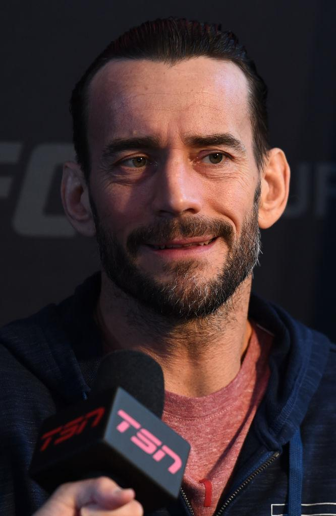CHICAGO, ILLINOIS - JUNE 07:   CM Punk interacts with media during the UFC 225 Ultimate Media Day at the United Center on June 7, 2018 in Chicago, Illinois. (Photo by Josh Hedges/Zuffa LLC/Zuffa LLC via Getty Images)