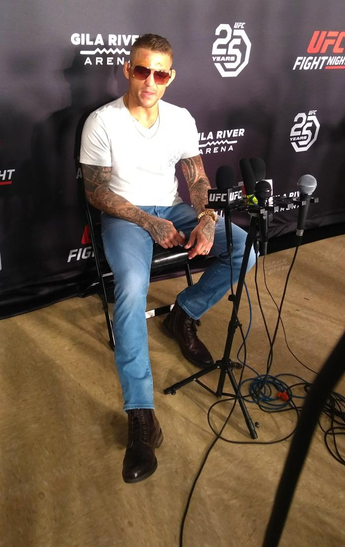 Dustin Poirier takes questions from the media while nursing an injured leg in the post-fight press conference following his victory over Justin Gaethje at Fight Night Glendale on April 4, 2018 (Photo by Steve Latrell/Zuffa LLC)