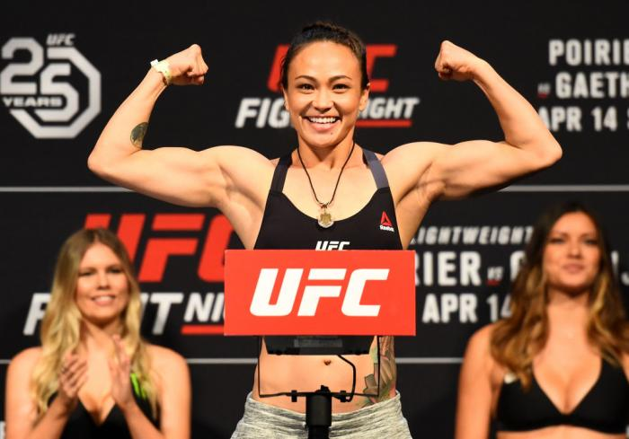 GLENDALE, AZ - APRIL 13:  Michelle Waterson poses on the scale during the UFC Fight Night weigh-in at the Gila Rivera Arena on April 13, 2018 in Glendale, Arizona. (Photo by Josh Hedges/Zuffa LLC/Zuffa LLC via Getty Images)