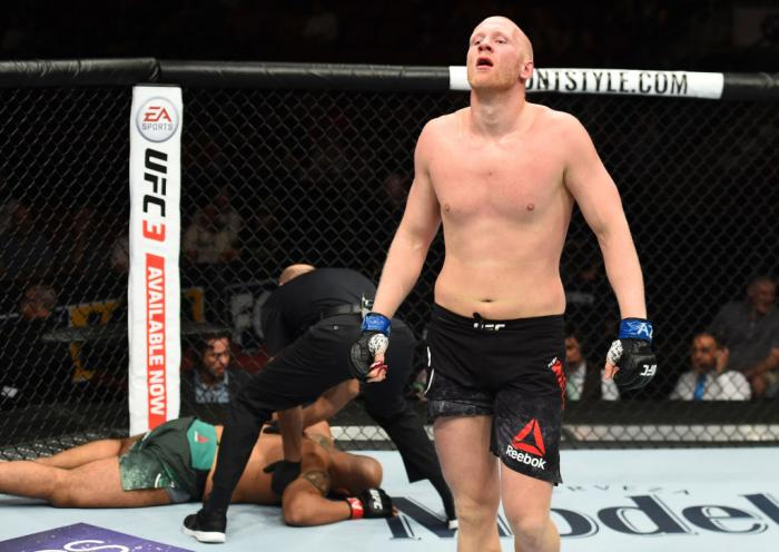 GLENDALE, AZ - APRIL 14:  (R-L) Adam Wieczorek of Poland celebrates his victory over Arjan Singh Bhullar of Canada in their heavyweight fight during the UFC Fight Night event at the Gila Rivera Arena on April 14, 2018 in Glendale, Arizona. (Photo by Josh