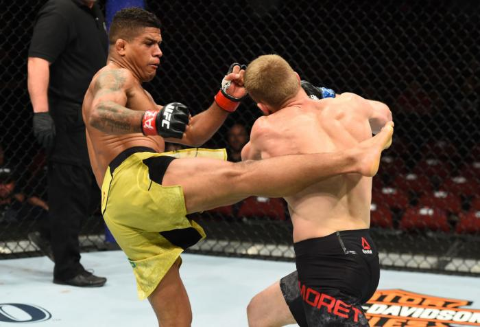 GLENDALE, AZ - APRIL 14:  (L-R) Gilbert Burns of Brasil kicks Dan Moret in their lightweight fight during the UFC Fight Night event at the Gila Rivera Arena on April 14, 2018 in Glendale, Arizona. (Photo by Josh Hedges/Zuffa LLC/Zuffa LLC via Getty Images