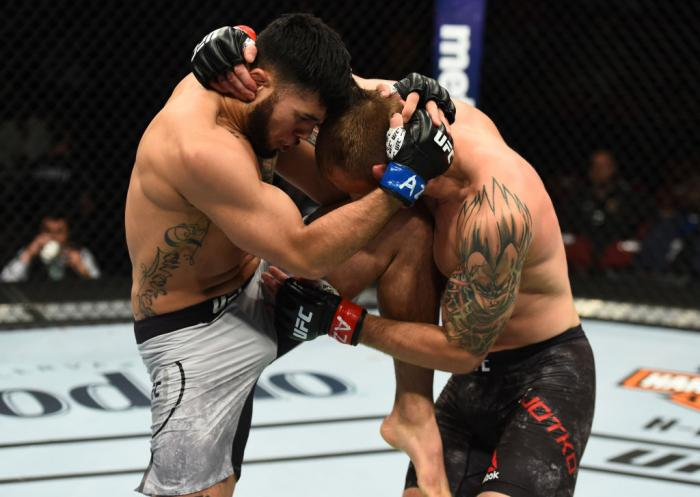 GLENDALE, AZ - APRIL 14:  (L-R) Brad Tavares knees Krzysztof Jotko of Poland in their middleweight fight during the UFC Fight Night event at the Gila Rivera Arena on April 14, 2018 in Glendale, Arizona. (Photo by Josh Hedges/Zuffa LLC/Zuffa LLC via Getty