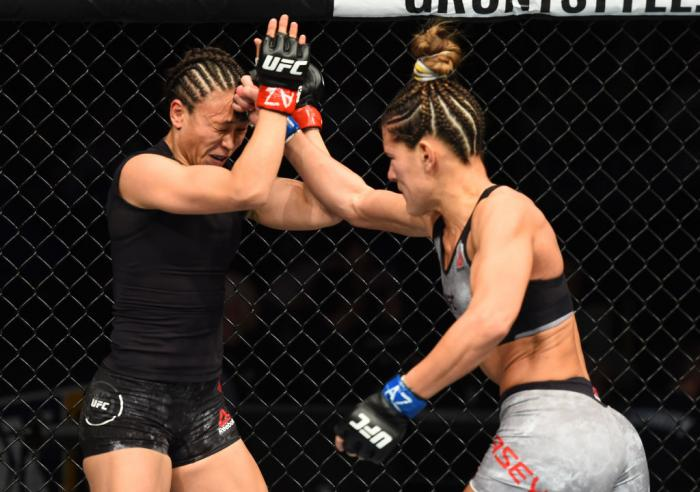 GLENDALE, AZ - APRIL 14:  (R-L) Cortney Casey punches Michelle Waterson in their womens strawweight fight during the UFC Fight Night event at the Gila Rivera Arena on April 14, 2018 in Glendale, Arizona. (Photo by Josh Hedges/Zuffa LLC/Zuffa LLC via Getty