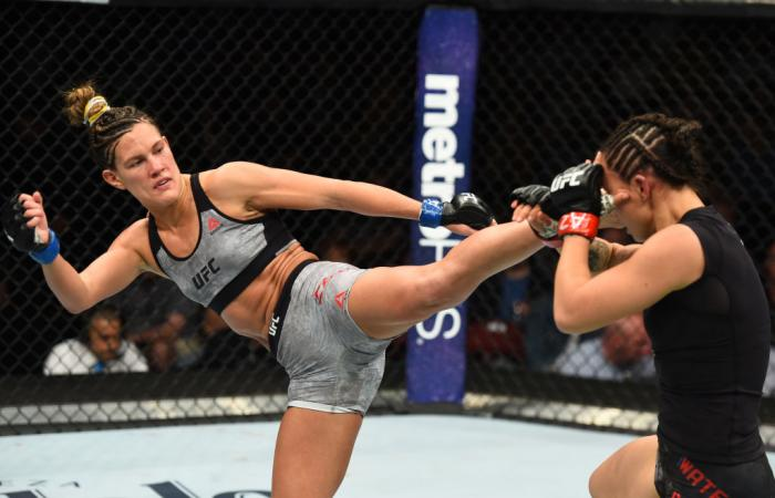 GLENDALE, AZ - APRIL 14:  (L-R) Cortney Casey kicks Michelle Waterson in their womens strawweight fight during the UFC Fight Night event at the Gila Rivera Arena on April 14, 2018 in Glendale, Arizona. (Photo by Josh Hedges/Zuffa LLC/Zuffa LLC via Getty I