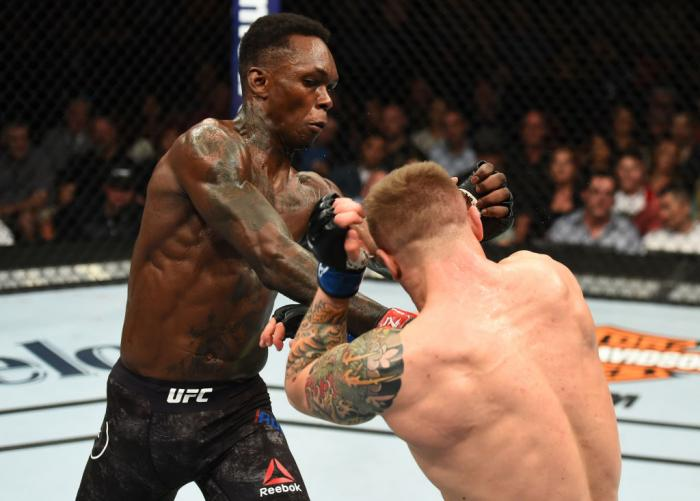 GLENDALE, AZ - APRIL 14:  (L-R) Israel Adesanya of Nigeria punches Marvin Vettori of Italy in their middleweight fight during the UFC Fight Night event at the Gila Rivera Arena on April 14, 2018 in Glendale, Arizona. (Photo by Josh Hedges/Zuffa LLC/Zuffa
