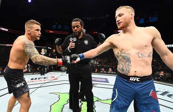 GLENDALE, AZ - APRIL 14:  (L-R) Dustin Poirier and Justin Gaethje touch gloves in their lightweight fight during the UFC Fight Night event at the Gila Rivera Arena on April 14, 2018 in Glendale, Arizona. (Photo by Josh Hedges/Zuffa LLC/Zuffa LLC via Getty