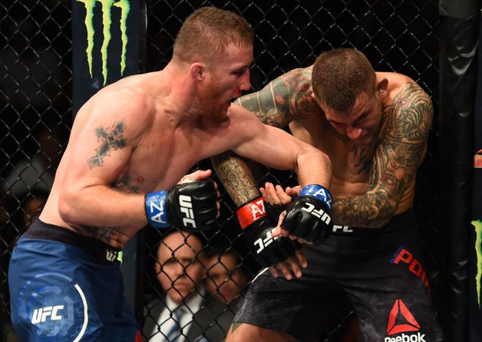 GLENDALE, AZ - APRIL 14:  (L-R) Justin Gaethje punches Dustin Poirier in their lightweight fight during the UFC Fight Night event at the Gila Rivera Arena on April 14, 2018 in Glendale, Arizona. (Photo by Josh Hedges/Zuffa LLC/Zuffa LLC via Getty Images)
