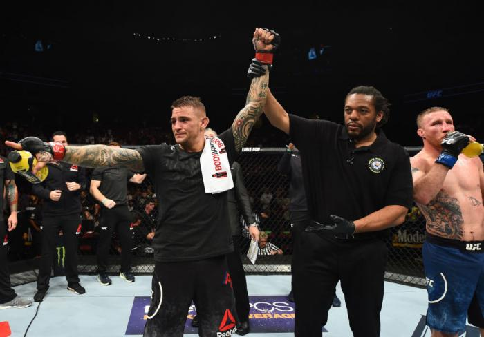 GLENDALE, AZ - APRIL 14:  Dustin Poirier celebrates his victory over Justin Gaethje in their lightweight fight during the UFC Fight Night event at the Gila Rivera Arena on April 14, 2018 in Glendale, Arizona. (Photo by Josh Hedges/Zuffa LLC/Zuffa LLC via
