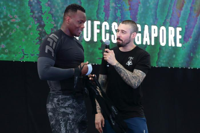 SINGAPORE - JUNE 20:  Ovince Saint Preux (L) of United States speaks to fans during the UFC Fight Night Open Workout at OCBC Square on June 20, 2018 in Singapore.  (Photo by Suhaimi Abdullah - Zuffa LLC/Zuffa LLC)