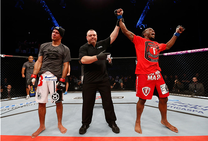 BELO HORIZONTE, BRAZIL - SEPTEMBER 04:  Sean Spencer (R) reacts after defeating Yuri Villefort in the welterweight fight during the UFC on FOX Sports 1 event at Mineirinho Arena on September 4, 2013 in Belo Horizonte, Brazil. (Photo by Josh Hedges/Zuffa L