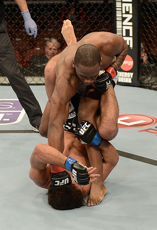 ANAHEIM, CA - FEBRUARY 23:  Nah-Shon Burrell (top) punches Yuri Villefort in their welterweight bout during UFC 157 at Honda Center on February 23, 2013 in Anaheim, California.  (Photo by Donald Miralle/Zuffa LLC/Zuffa LLC via Getty Images) *** Local Capt