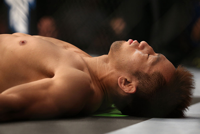 DENVER, CO - AUGUST 11:  Eiji Mitsuoka lies on the canvas before his bout against Nik Lentz at UFC 150 inside Pepsi Center on August 11, 2012 in Denver, Colorado. (Photo by Josh Hedges/Zuffa LLC/Zuffa LLC via Getty Images)