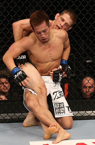 DENVER, CO - AUGUST 11:  (R-L) Nik Lentz and Eiji Mitsuoka grapple during their featherweight bout at UFC 150 inside Pepsi Center on August 11, 2012 in Denver, Colorado. (Photo by Nick Laham/Zuffa LLC/Zuffa LLC via Getty Images)