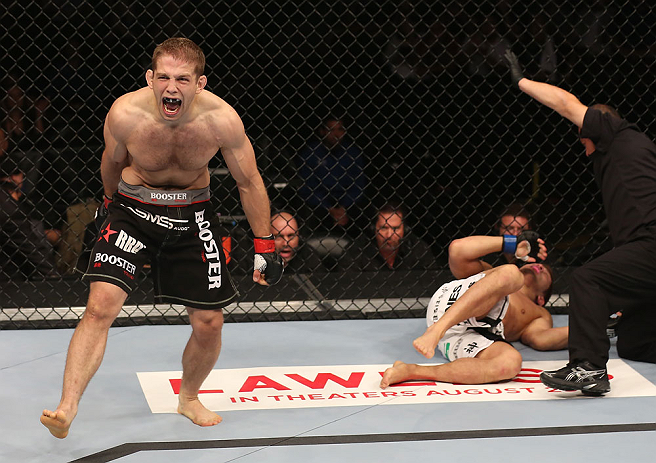 DENVER, CO - AUGUST 11:  Nik Lentz (L) reacts after defeating Eiji Mitsuoka during their featherweight bout at UFC 150 inside Pepsi Center on August 11, 2012 in Denver, Colorado. (Photo by Nick Laham/Zuffa LLC/Zuffa LLC via Getty Images)