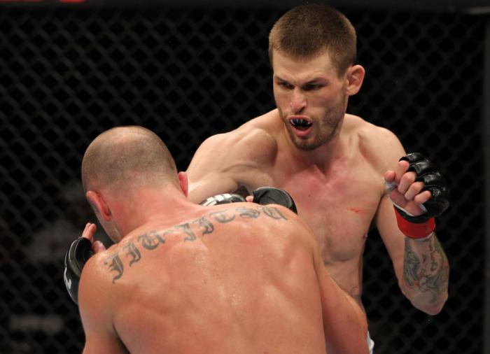 OMAHA, NE - FEBRUARY 15:  (R-L) Tim Means punches Bernardo Magalhaes during the UFC on FUEL TV event at Omaha Civic Auditorium on February 15, 2012 in Omaha, Nebraska.  (Photo by Josh Hedges/Zuffa LLC/Zuffa LLC via Getty Images) *** Local Caption *** Tim