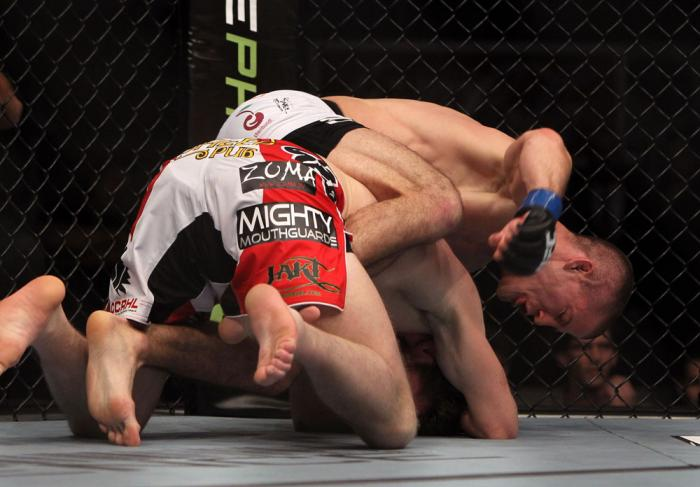 TORONTO, ON - DECEMBER 10:  (R-L) John Cholish punches Mitch Clarke during the UFC 140 event at Air Canada Centre on December 10, 2011 in Toronto, Ontario, Canada.  (Photo by Josh Hedges/Zuffa LLC/Zuffa LLC via Getty Images)