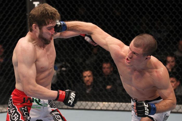 TORONTO, ON - DECEMBER 10:  (R-L) John Cholish punches Mitch Clarke during the UFC 140 event at Air Canada Centre on December 10, 2011 in Toronto, Canada.  (Photo by Nick Laham/Zuffa LLC/Zuffa LLC)