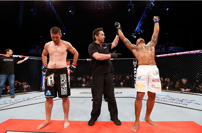 BELO HORIZONTE, BRAZIL - SEPTEMBER 04:  Ivan Jorge (R) reacts after his victory over Keith Wisniewski in their welterweight fight during the UFC on FOX Sports 1 event at Mineirinho Arena on September 4, 2013 in Belo Horizonte, Brazil. (Photo by Josh Hedge