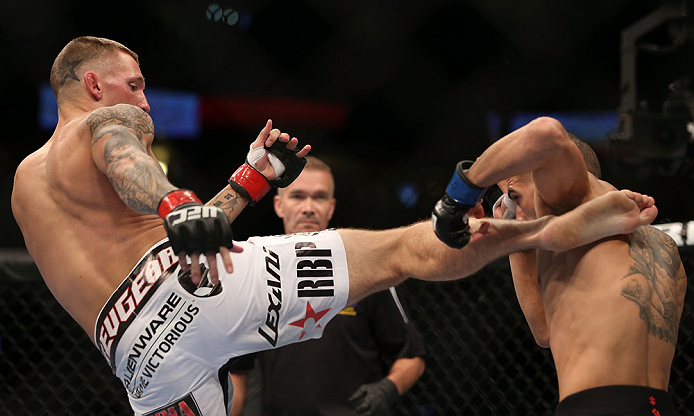 DENVER, CO - AUGUST 11:  (L-R) Dustin Pague kicks Chico Camus during their bantamweight bout at UFC 150 inside Pepsi Center on August 11, 2012 in Denver, Colorado. (Photo by Josh Hedges/Zuffa LLC/Zuffa LLC via Getty Images)