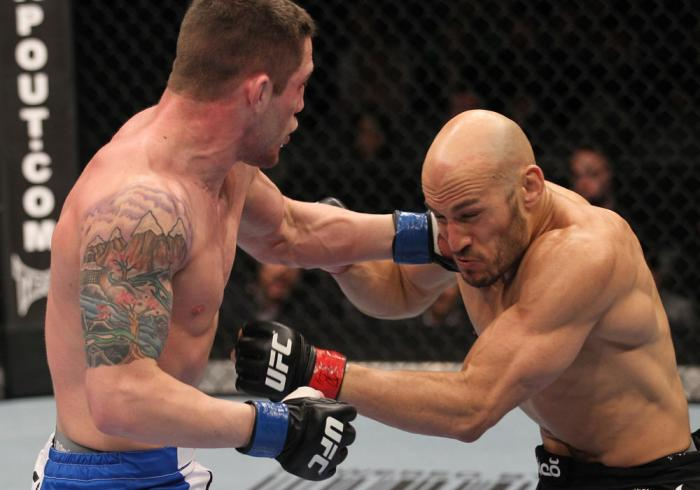 TORONTO, ON - DECEMBER 10:  (L-R) Jake Hecht punches Rich Attonito during the UFC 140 event at Air Canada Centre on December 10, 2011 in Toronto, Ontario, Canada.  (Photo by Nick Laham/Zuffa LLC/Zuffa LLC via Getty Images)