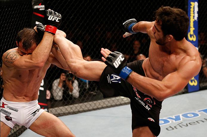 BELO HORIZONTE, BRAZIL - SEPTEMBER 04:  (R-L) Elias Silverio kicks Joao Zeferino in their welterweight fight during the UFC on FOX Sports 1 event at Mineirinho Arena on September 4, 2013 in Belo Horizonte, Brazil. (Photo by Josh Hedges/Zuffa LLC/Zuffa LLC
