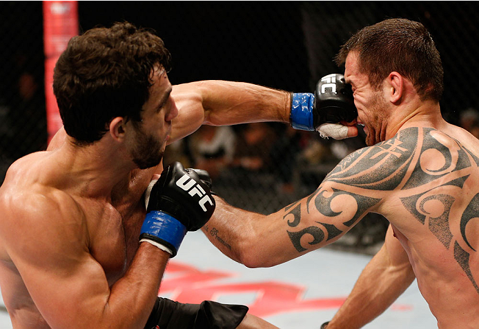 BELO HORIZONTE, BRAZIL - SEPTEMBER 04:  (L-R) Elias Silverio punches Joao Zeferino in their welterweight fight during the UFC on FOX Sports 1 event at Mineirinho Arena on September 4, 2013 in Belo Horizonte, Brazil. (Photo by Josh Hedges/Zuffa LLC/Zuffa L