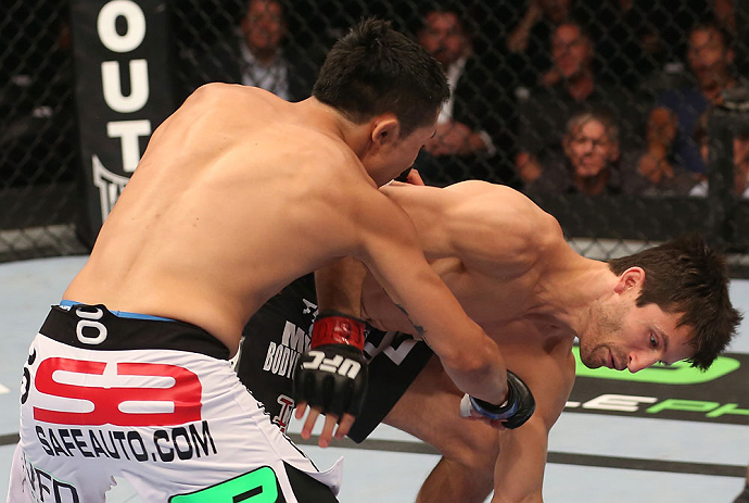 DENVER, CO - AUGUST 11:  (L-R) Erik Perez knocks down Ken Stone with a punch during their bantamweight bout at UFC 150 inside Pepsi Center on August 11, 2012 in Denver, Colorado. (Photo by Nick Laham/Zuffa LLC/Zuffa LLC via Getty Images)