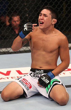 DENVER, CO - AUGUST 11:  Erik Perez reacts after knocking out Ken Stone during their bantamweight bout at UFC 150 inside Pepsi Center on August 11, 2012 in Denver, Colorado. (Photo by Nick Laham/Zuffa LLC/Zuffa LLC via Getty Images)