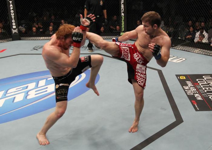 TORONTO, ON - DECEMBER 10:  (R-L) Nik Lentz kicks Mark Bocek during the UFC 140 event at Air Canada Centre on December 10, 2011 in Toronto, Ontario, Canada.  (Photo by Nick Laham/Zuffa LLC/Zuffa LLC via Getty Images)