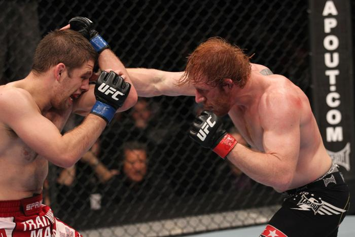 TORONTO, ON - DECEMBER 10:  (R-L) Mark Bocek punches Nik Lentz during the UFC 140 event at Air Canada Centre on December 10, 2011 in Toronto, Ontario, Canada.  (Photo by Nick Laham/Zuffa LLC/Zuffa LLC via Getty Images)