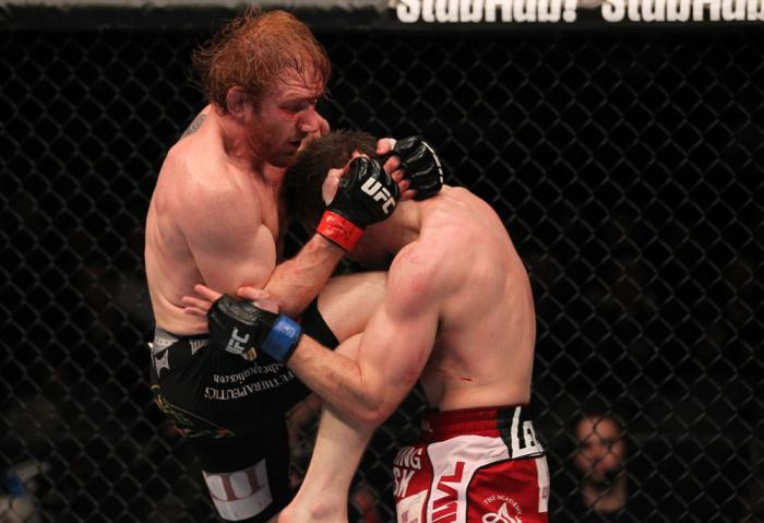 TORONTO, ON - DECEMBER 10:  (L-R) Mark Bocek delivers a knee strike against Nik Lentz during the UFC 140 event at Air Canada Centre on December 10, 2011 in Toronto, Ontario, Canada.  (Photo by Nick Laham/Zuffa LLC/Zuffa LLC via Getty Images)
