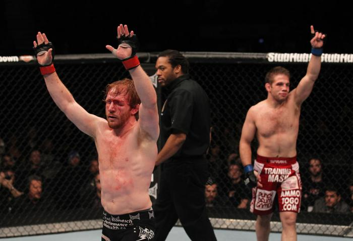 TORONTO, ON - DECEMBER 10:  Mark Bocek (L) and Nik Lentz (R) react after their three-round battle during the UFC 140 event at Air Canada Centre on December 10, 2011 in Toronto, Ontario, Canada.  (Photo by Nick Laham/Zuffa LLC/Zuffa LLC via Getty Images)