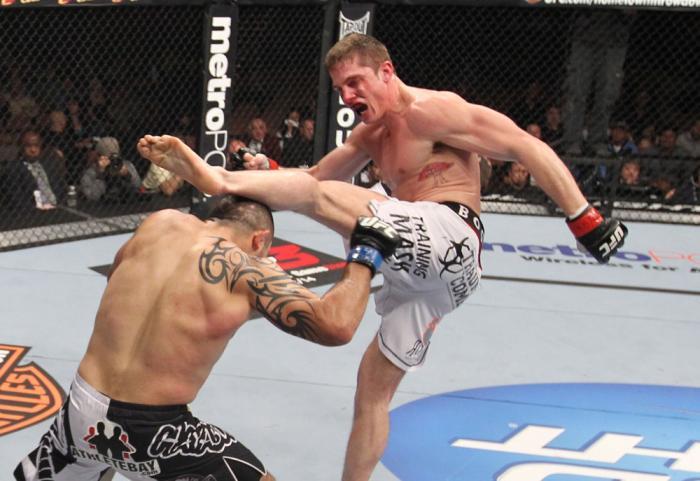 LAS VEGAS, NV - FEBRUARY 04:  (R-L) Matt Riddle kicks Henry Martinez during the UFC 143 event at Mandalay Bay Events Center on February 4, 2012 in Las Vegas, Nevada.  (Photo by Nick Laham/Zuffa LLC/Zuffa LLC via Getty Images) *** Local Caption *** Matt Ri
