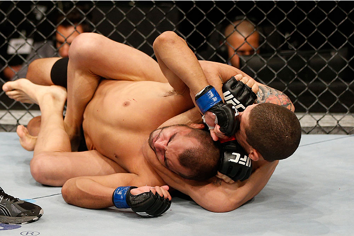 BELO HORIZONTE, BRAZIL - SEPTEMBER 04:  (R-L) Lucas Martins secures a rear choke submission against Junior Hernandez in their bantamweight fight during the UFC on FOX Sports 1 event at Mineirinho Arena on September 4, 2013 in Belo Horizonte, Brazil. (Phot