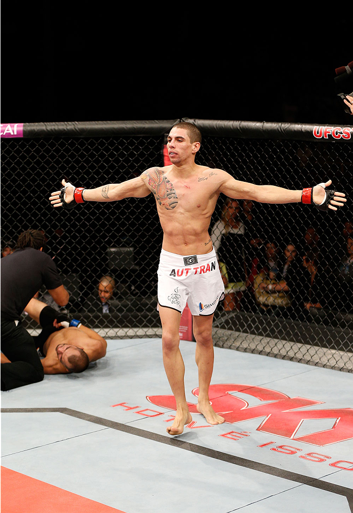 BELO HORIZONTE, BRAZIL - SEPTEMBER 04:  Lucas Martins reacts after his submission victory over Junior Hernandez in their bantamweight fight during the UFC on FOX Sports 1 event at Mineirinho Arena on September 4, 2013 in Belo Horizonte, Brazil. (Photo by