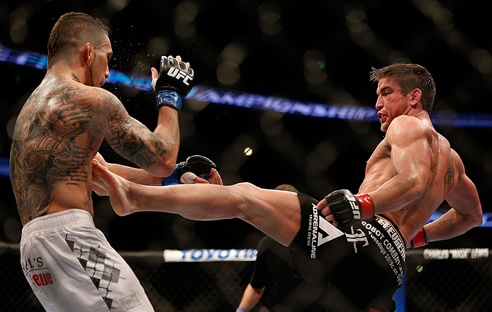 ANAHEIM, CA - FEBRUARY 23:  (R-L) Sam Stout kicks Caros Fodor in their lightweight bout during UFC 157 at Honda Center on February 23, 2013 in Anaheim, California.  (Photo by Josh Hedges/Zuffa LLC/Zuffa LLC via Getty Images) *** Local Caption *** Sam Stou