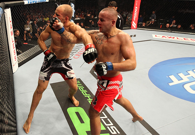 DENVER, CO - AUGUST 11:  (R-L) Michael Kuiper knocks out Jared Hamman with a punch during their middleweight bout at UFC 150 inside Pepsi Center on August 11, 2012 in Denver, Colorado. (Photo by Nick Laham/Zuffa LLC/Zuffa LLC via Getty Images)