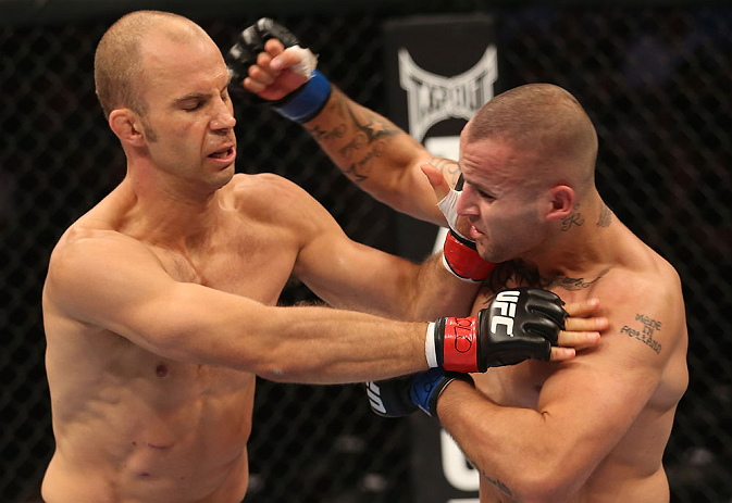 DENVER, CO - AUGUST 11:  (R-L) Michael Kuiper punches Jared Hamman during their middleweight bout at UFC 150 inside Pepsi Center on August 11, 2012 in Denver, Colorado. (Photo by Nick Laham/Zuffa LLC/Zuffa LLC via Getty Images)