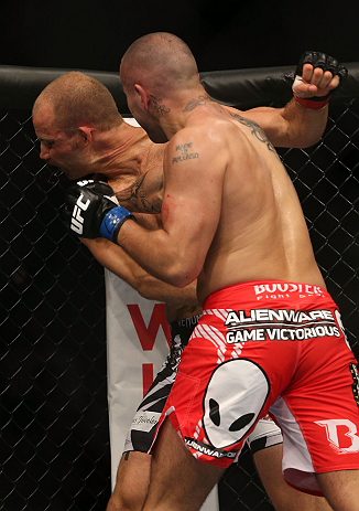 DENVER, CO - AUGUST 11:  (R-L) Michael Kuiper punches Jared Hamman during their middleweight bout at UFC 150 inside Pepsi Center on August 11, 2012 in Denver, Colorado. (Photo by Josh Hedges/Zuffa LLC/Zuffa LLC via Getty Images)