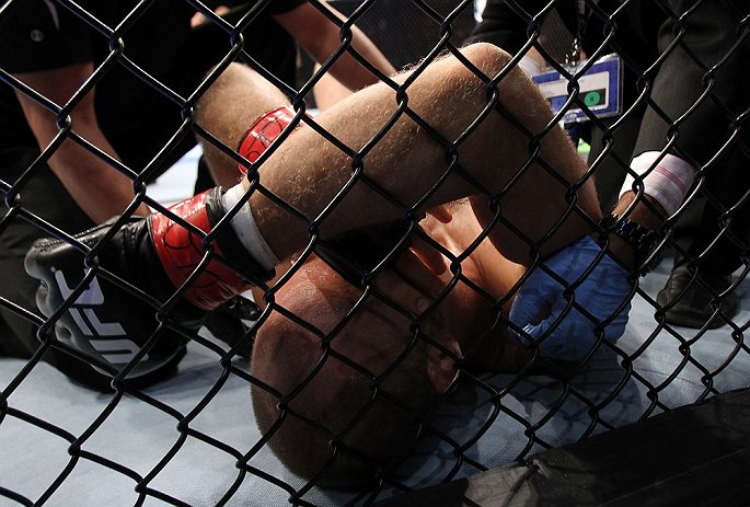 DENVER, CO - AUGUST 11:  Jared Hamman lies on the canvas after being knocked out by Michael Kuiper during their middleweight bout at UFC 150 inside Pepsi Center on August 11, 2012 in Denver, Colorado. (Photo by Josh Hedges/Zuffa LLC/Zuffa LLC via Getty Im
